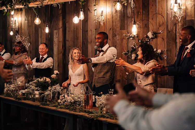 Wedding reception speeches at Wharfedale Grange with hanging festoon lights
