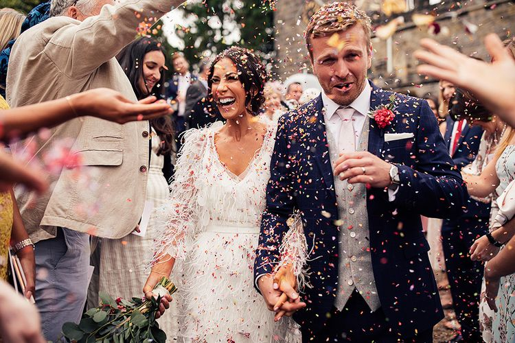 Confetti Moment with Bride in Emma Beaumont Wedding Dress and Groom in Navy Suit