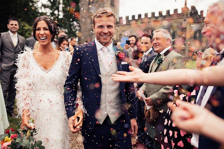 Confetti Exit with Bride in Feather Wedding Dress and Groom in Three Piece Suit