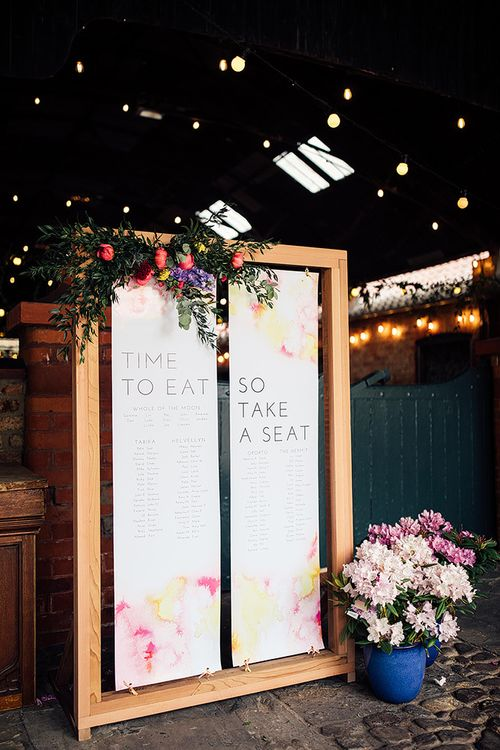 Wooden Framed Table Plan Decorated with Spring Wedding Flowers