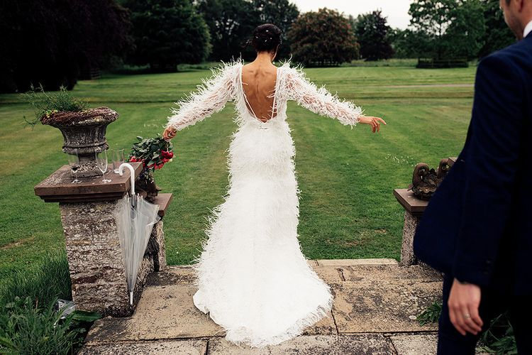 Bride in Wedding Dress with Feathers and Low Back
