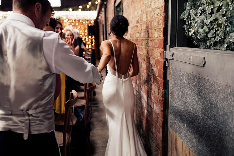 Bride in Emma Beaumont Wedding Dress with Straps and Low Back Detail