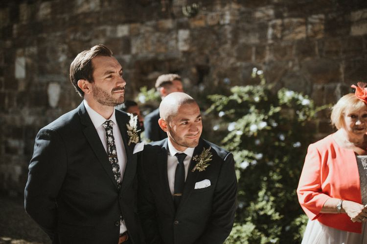 Groom In Navy Suit With Dark Floral Tie // Image By James Frost Photography