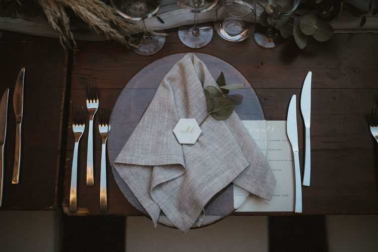 Geometric Marbled Place Name With Foliage Runner And Grey Linen Napkins // Image By James Frost Photography