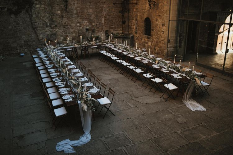 Ivory Tapered Candles With Foliage Runner And Grey Linen Napkins // Image By James Frost Photography