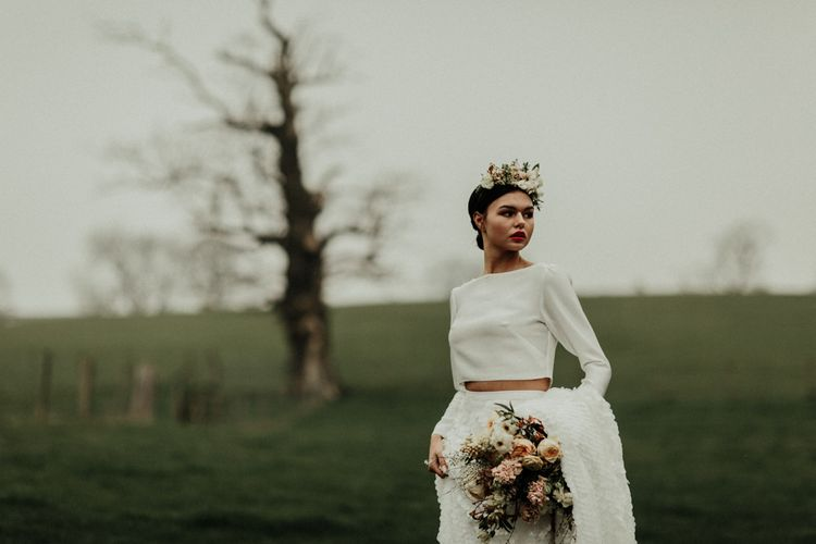 Boho bride in flower crown and bridal crop top with long sleeves
