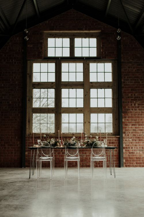 Elegant tablescape at The Giraffe Shed with Ghost chairs and bridal crop top