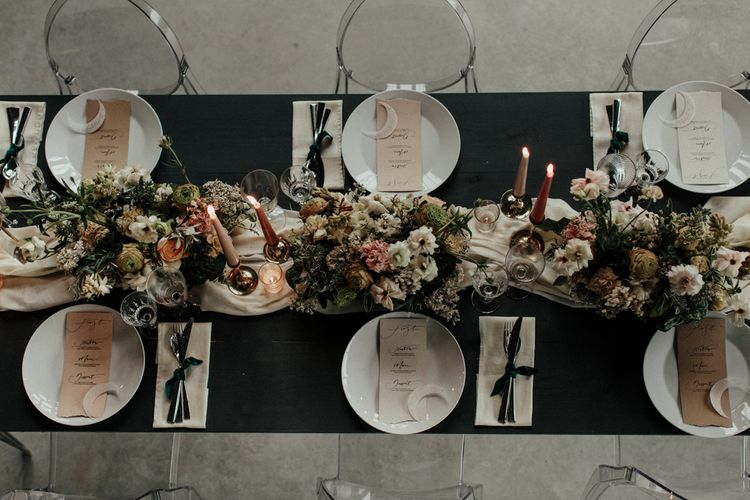 Intimate reception tablescape with flower and candle centrepiece decor