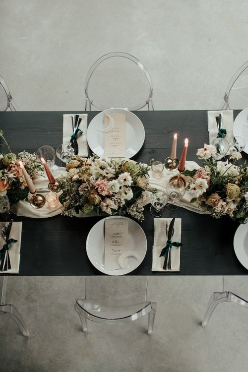 Romantic reception tablescape with flower and candle centrepiece decor