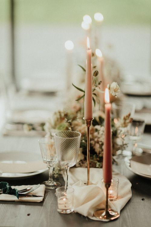Pink taper candles in gold candlesticks