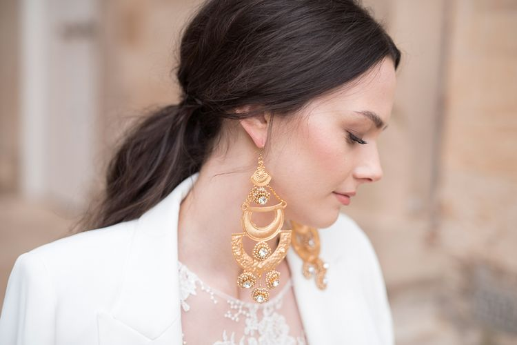 Bride with Gold Statement Earrings and Sleek Ponytail Hairstyle