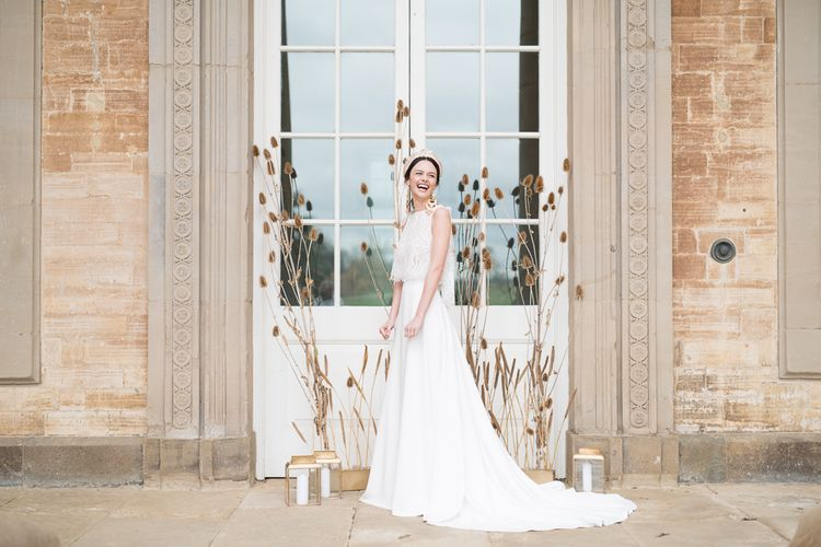 Laughing Bride in Turban Headband and Jesus Peiro Wedding Dress  Standing in Front of a Dried Flowers, Minimalist Floral Installation