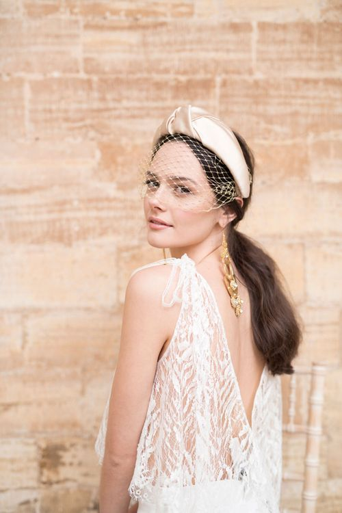 Beautiful Bride in Jesus Peiro Wedding Dress with Natural Makeup and On-Trend Turban Headband with birdcage Veil and Statement Gold Earrings