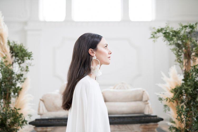 Sleek Wedding Hairstyle  Showing Off Statement Earrings