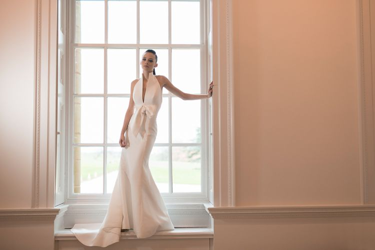 Bride in Fitted Jesus Peiro Wedding Dress with Collar and Bow Detail