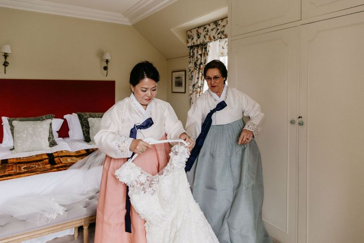 Mother of the bride and groom in tailor-made Hanboks - Korean wedding dress