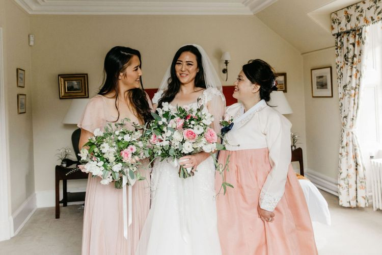 Bride with mother and sister on wedding morning