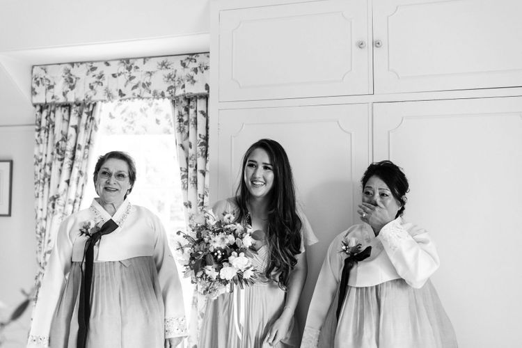Emotional bridal party first look with mother of the bride in Korean wedding dress