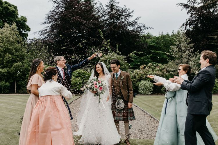 Confetti moment at Elsick House with Korean wedding dress
