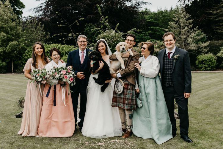 Intimate wedding party portrait with pet dogs
