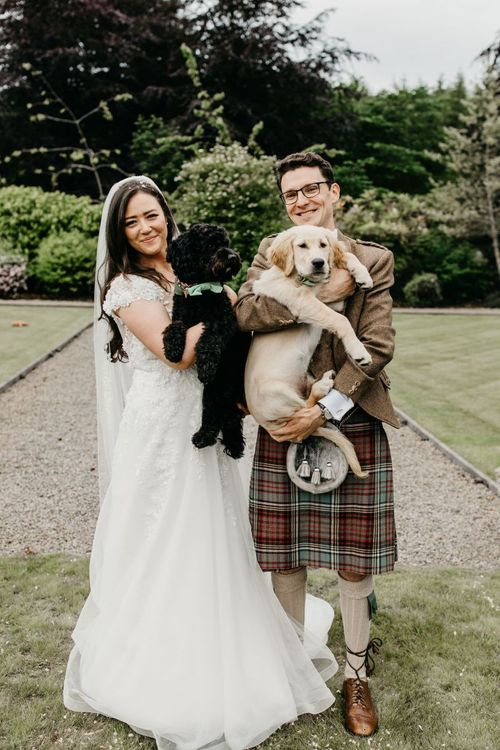 Bride and groom with their pet dogs