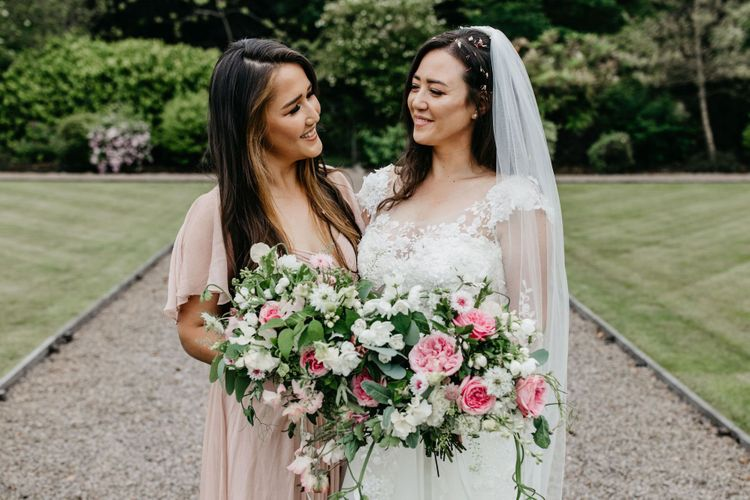 Bride with her bridesmaid in a dusky pink dress
