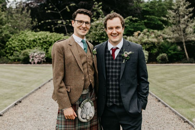 Scottish groom in a kilt with his best man