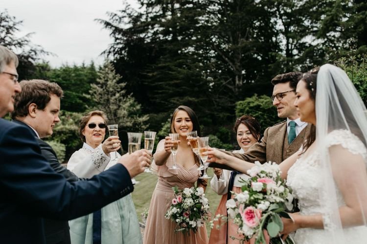 Champagne toast at socially distanced wedding