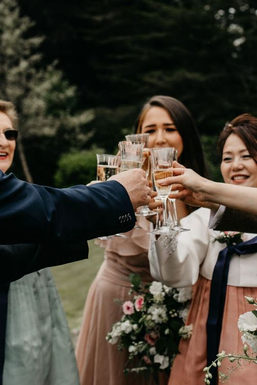 Clinking Champagne Glasses at intimate wedding