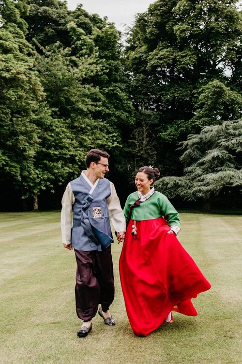Bride and groom in tailor made Korean wedding dress