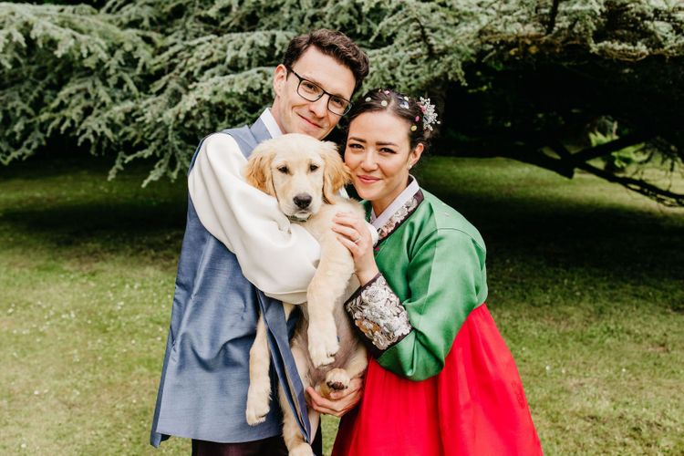 Bride and groom in Korean Hanboks with their pet dog