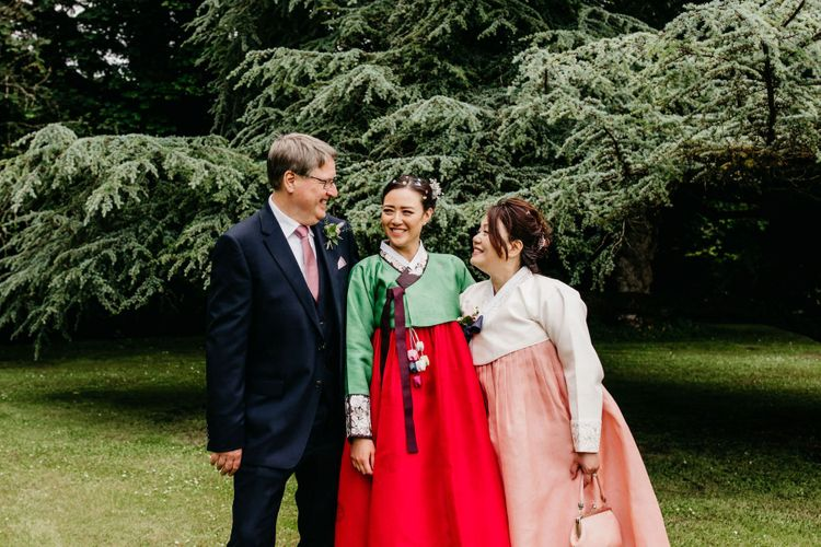 Bride and mother of the bride in tailor-made Koren wedding dress outfits