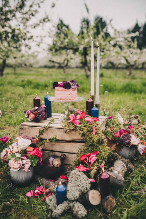 Wooden Crate with Single Tier Cake, Candles and Floral Wedding Decor