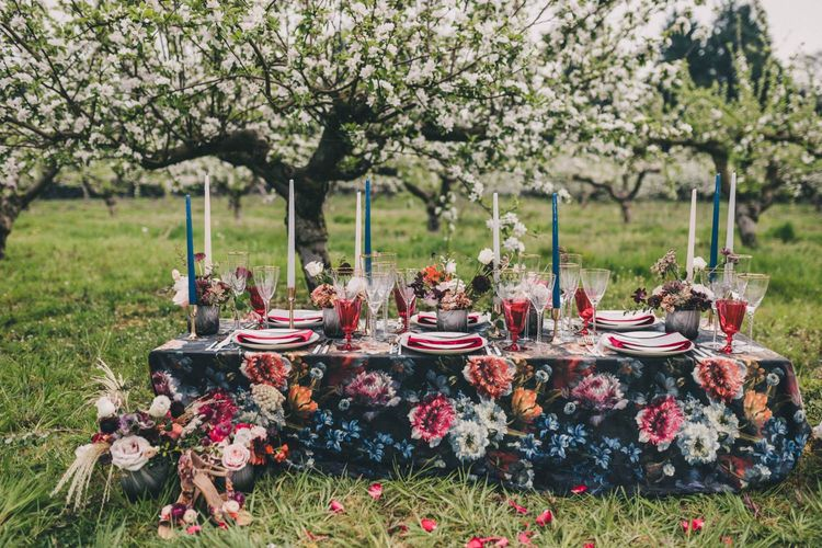 Vibrant Floral Tablescape with Taper Candles and Plush Napkins