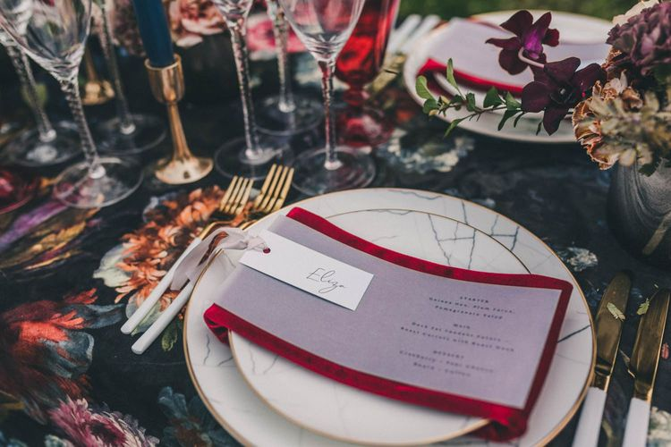 Place Setting with Marble Tableware and Red Napkin