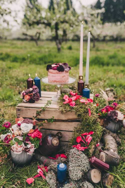 Wedding Cake Display with Rustic Crate, Coloured Candles and Flowers