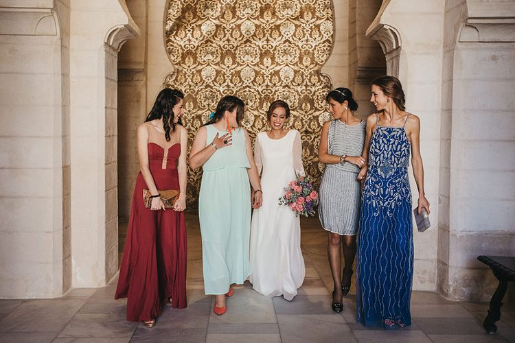 Bridesmaids In Brightly Coloured Dresses // Spanish Castle Wedding With Bride In Backless Marcos Souza And Images From Lísola Photography