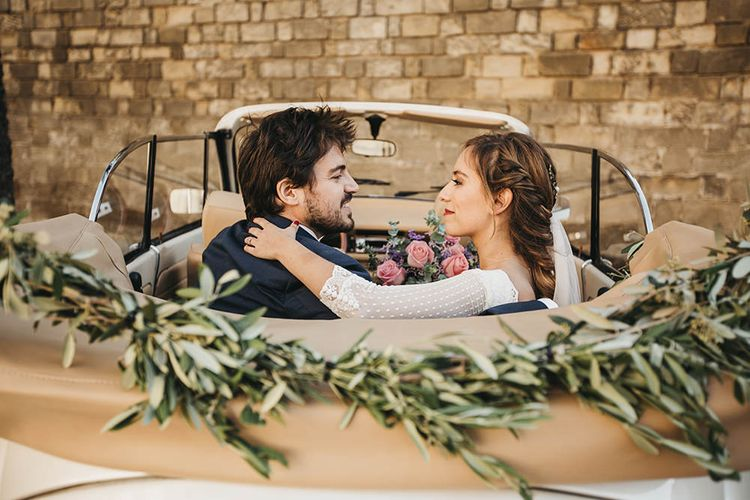 Vintage Car With Foliage Runner For Wedding // Spanish Castle Wedding With Bride In Backless Marcos Souza And Images From Lísola Photography