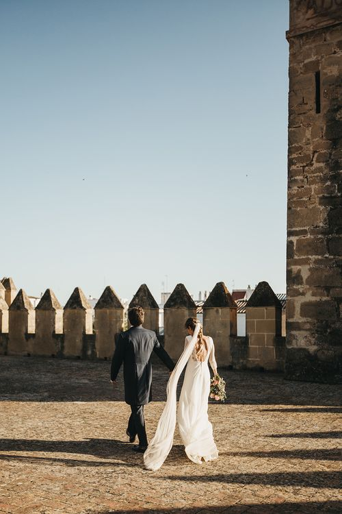 Spanish Castle Wedding With Bride With Braided Hair And Wearing In Backless Marcos Souza And Images From Lísola Photography