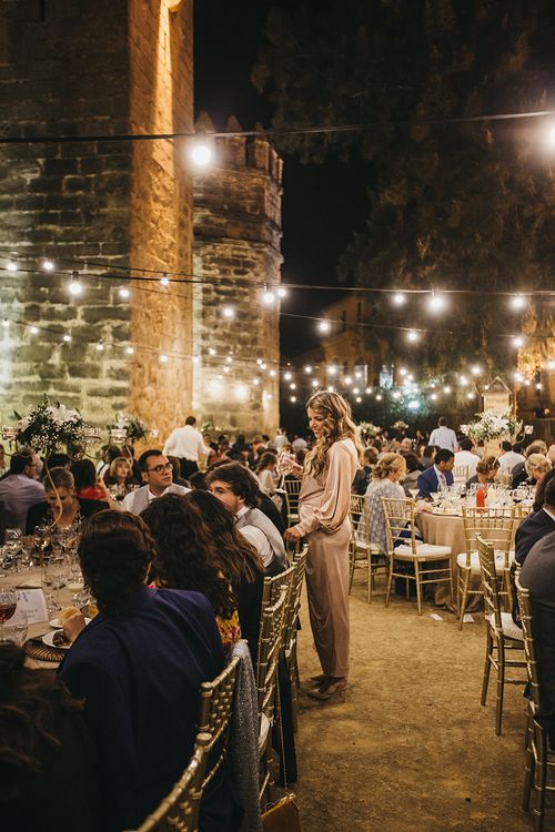 Festoon Lit Wedding Reception // Spanish Castle Wedding With Bride With Braided Hair And Wearing In Backless Marcos Souza And Images From Lísola Photography