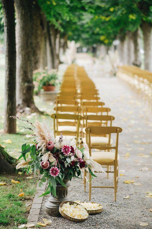 Outdoor Ceremony Aisle with Floral Arrangement Decor | Glamorous, Roaring Twenties, Great Gatsby Inspired Wedding at Villa Borromeo  in Italy | Matrimoni all'Italiana Photography