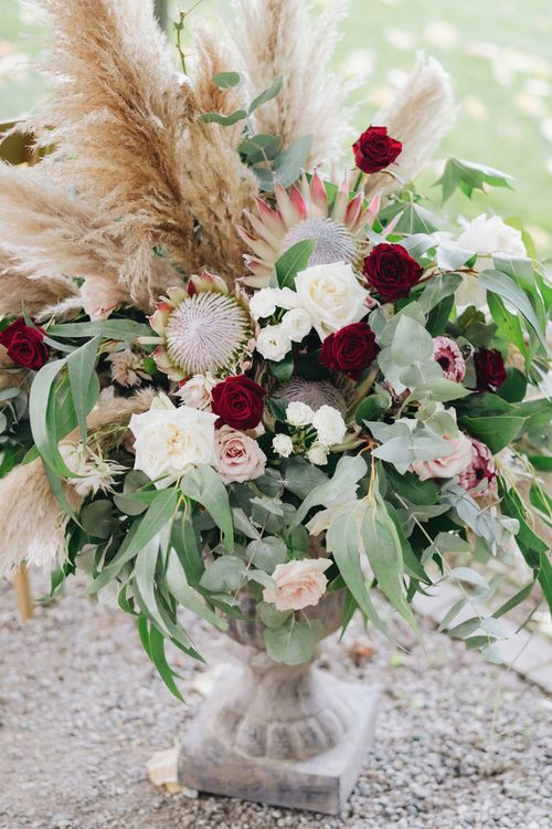 Red, Pink & White Roses with Proteas & Pampas Grass Floral Arrangement | Glamorous, Roaring Twenties, Great Gatsby Inspired Wedding at Villa Borromeo  in Italy | Matrimoni all'Italiana Photography