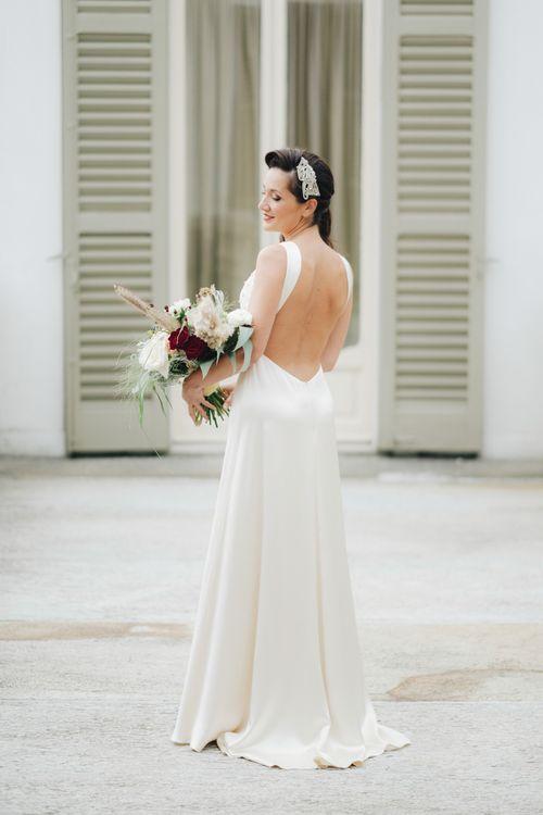Backless Silk Jenny Packham Wedding Dress | Glamorous, Roaring Twenties, Great Gatsby Inspired Wedding at Villa Borromeo  in Italy | Matrimoni all'Italiana Photography