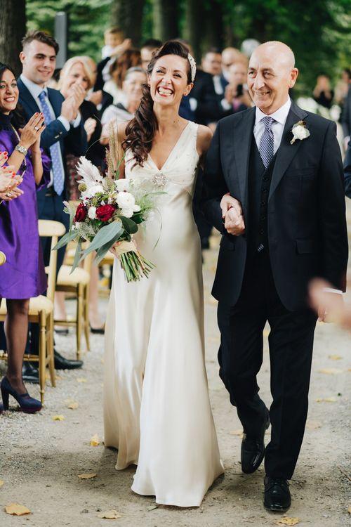 Outdoor Wedding Ceremony | Bridal Entrance in Silk Jenny Packham Gown | Glamorous, Roaring Twenties, Great Gatsby Inspired Wedding at Villa Borromeo  in Italy | Matrimoni all'Italiana Photography