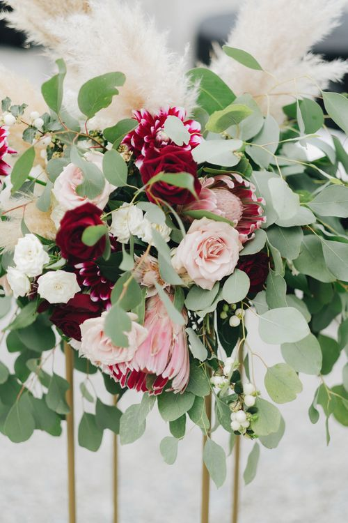 Red, Pink & White Floral Arrangement with Proteas & Pampas Grass | Glamorous, Roaring Twenties, Great Gatsby Inspired Wedding at Villa Borromeo  in Italy | Matrimoni all'Italiana Photography