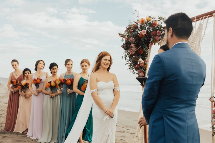 Bride and Groom With Bridesmaids wearing Colourful Dresses