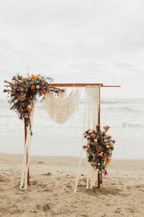 Beach Altar With Macrame And Flower Decor