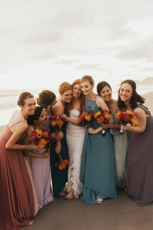 Bridal Party In Colourful Bridesmaid Dresses and Bright Bouquets