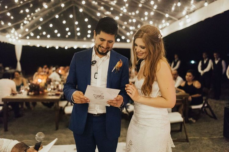 Bride and Groom Enjoy Reading Guests Notes