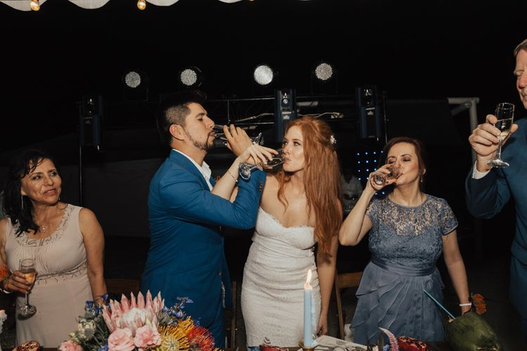 Bride and Groom Link Arms To Drink Champagne